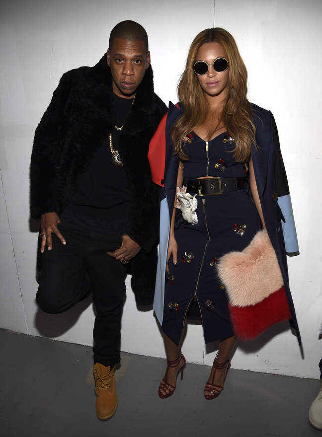 Jay-Z (L) and Beyonce pose backstage at the adidas Originals x Kanye West YEEZY SEASON 1 fashion show during New York Fashion Week Fall 2015 at Skylight Clarkson Sq on February 12, 2015 in New York City