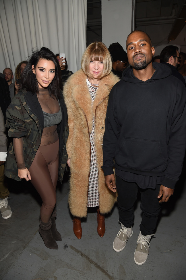 Kim Kardashian, Anna Wintour, and Kanye West pose backstage at the adidas Originals x Kanye West YEEZY SEASON 1 fashion show during New York Fashion Week Fall 2015 at Skylight Clarkson Sq on February 12, 2015 in New York City