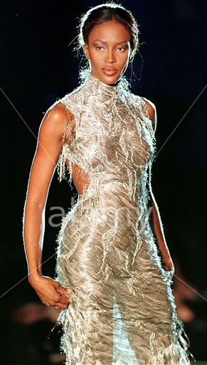 Naomi Campbell modelling a mesh dress designed July 1998 by Donatella Versace for Paris Haute Couture Week